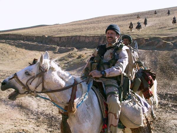 U.S. Air Force Combat Controller Staff Sgt. Bart Decker, horseback alongside the Northern Alliance in Afghanistan 2001.