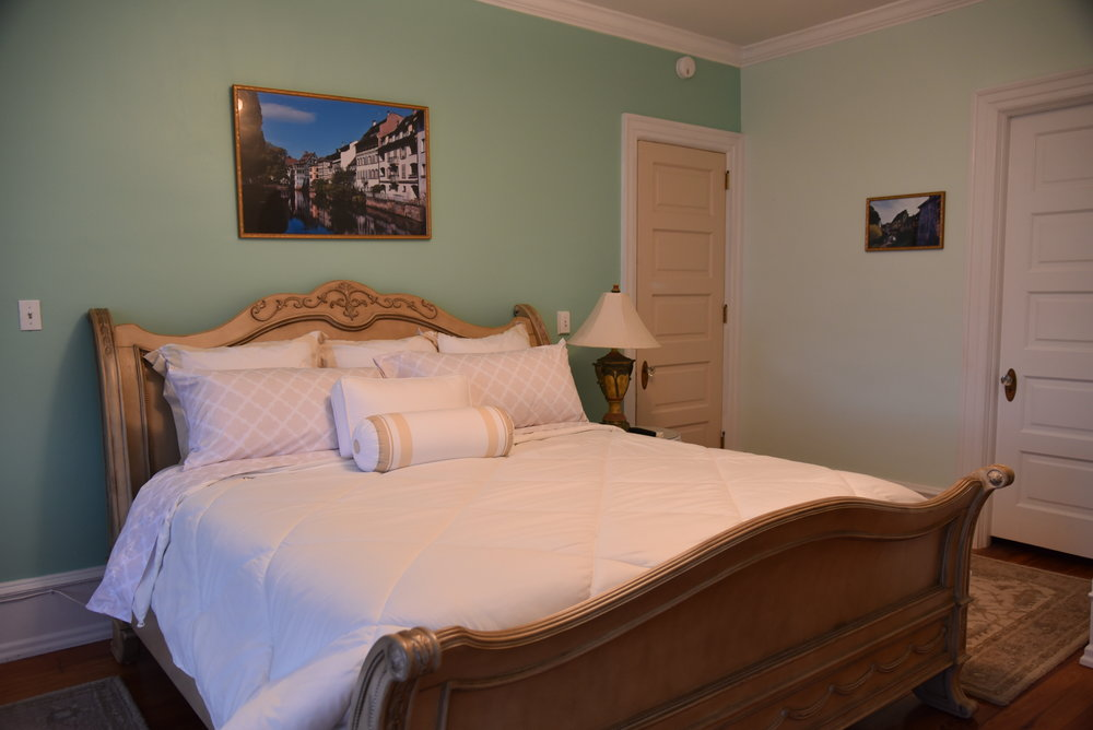 The Colmar Room - The Colmar Room is a perfect combination of elegance and space. Featuring 200 square feet with one King Bed.  French Provincial decor with vibrant color is unique to this room. The original Master Bedroom and Bathroom, built in 1908, the Colmar Room has maintained this distinctive look celebrating luxury, elegance and history.$80.00/$85.00 per night Book Now