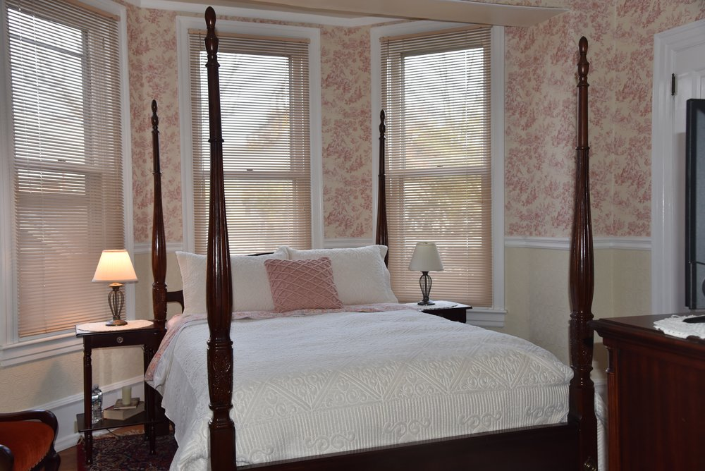 The Heidelberg Room - The Heidelberg Room is charming and picturesque. Featuring one Queen Bed with 150 square feet. Toile decor accents the four poster bed and German antiques. If you love the idea of staying in an quaint room that is traditional in every way from decor to hospitality, you won't find anything better.$75.oo/$80.00 per nightBook Now