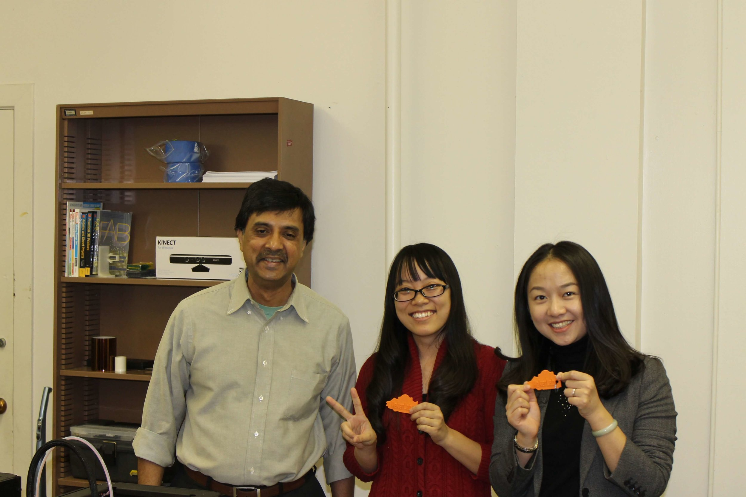 Madhu Vishwanathan, Professor of Business Administration and Diane and Steven N. Miller Endowed Professor , with Phd students showing off their creations.