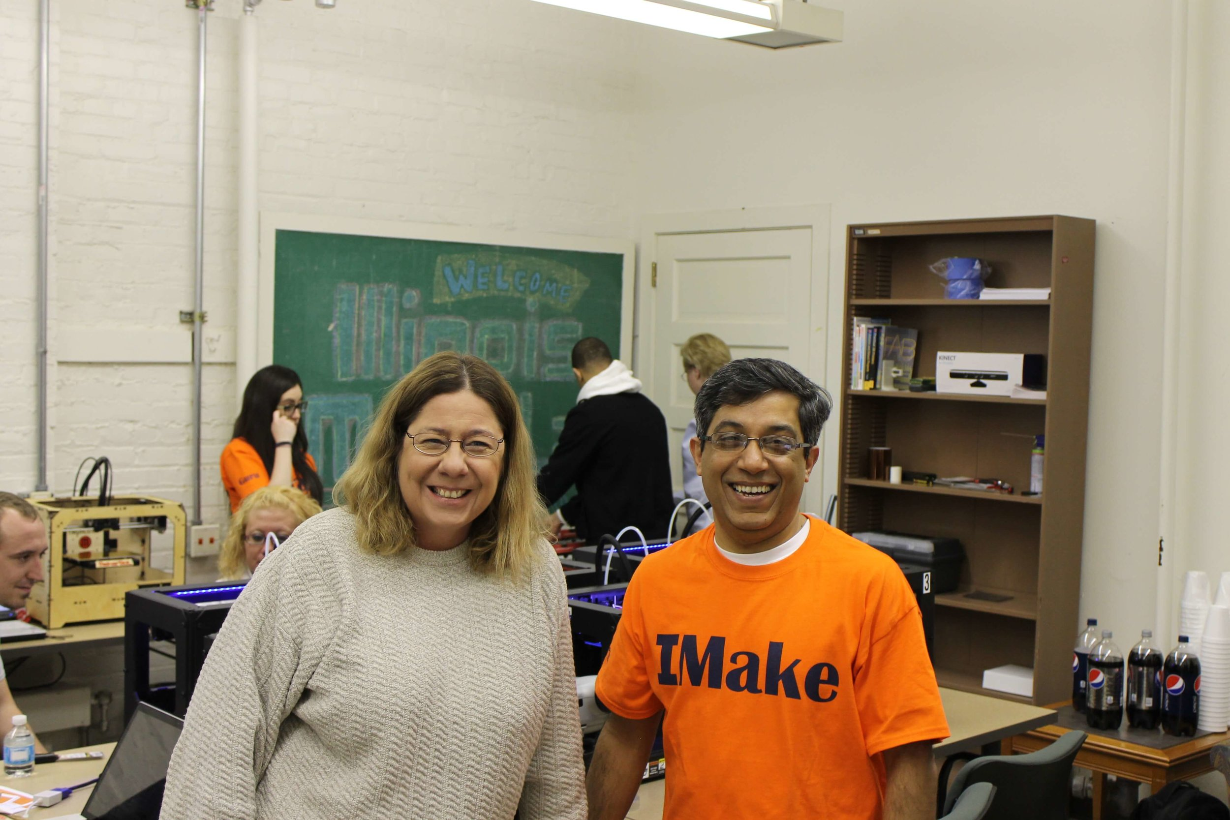 Becky Smith,Head, Business and Economics Library and Associate Professor , with Vishal Sachdev, Director, MakerLab. Becky showing her support for the Maker Movement