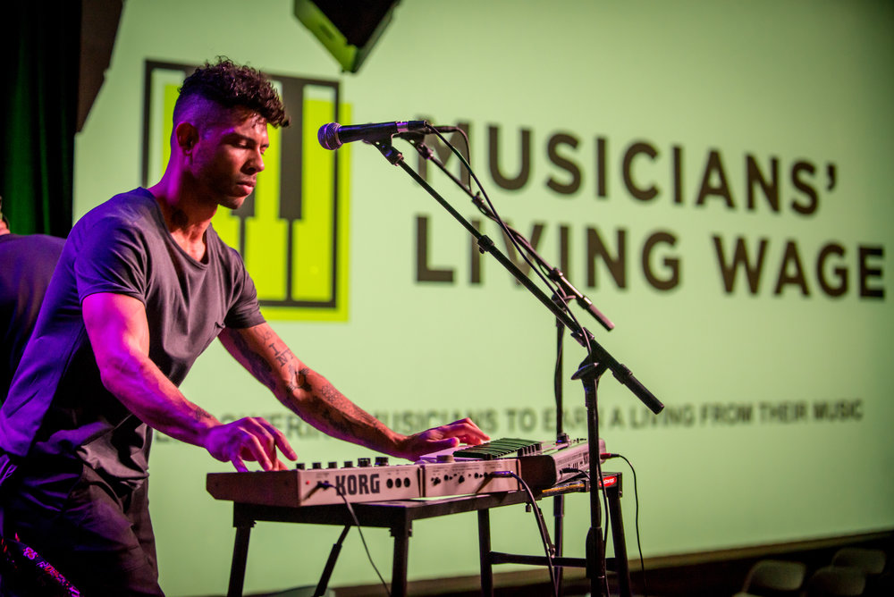 Jonathan Horstmann,  synth/guitar player for  BLXPTN  at the Musicians' Living Wage kick-off event at The North Door, Feb 21st, 2018.