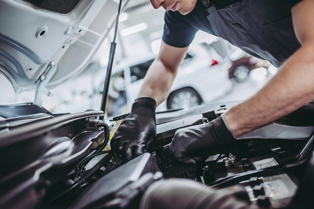 bigstock-Handsome-Auto-Service-Mechanic-208647751.jpg