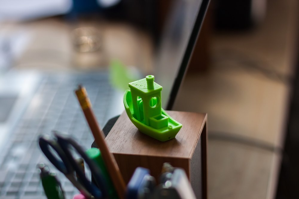 Simple figurines, like a green boat.