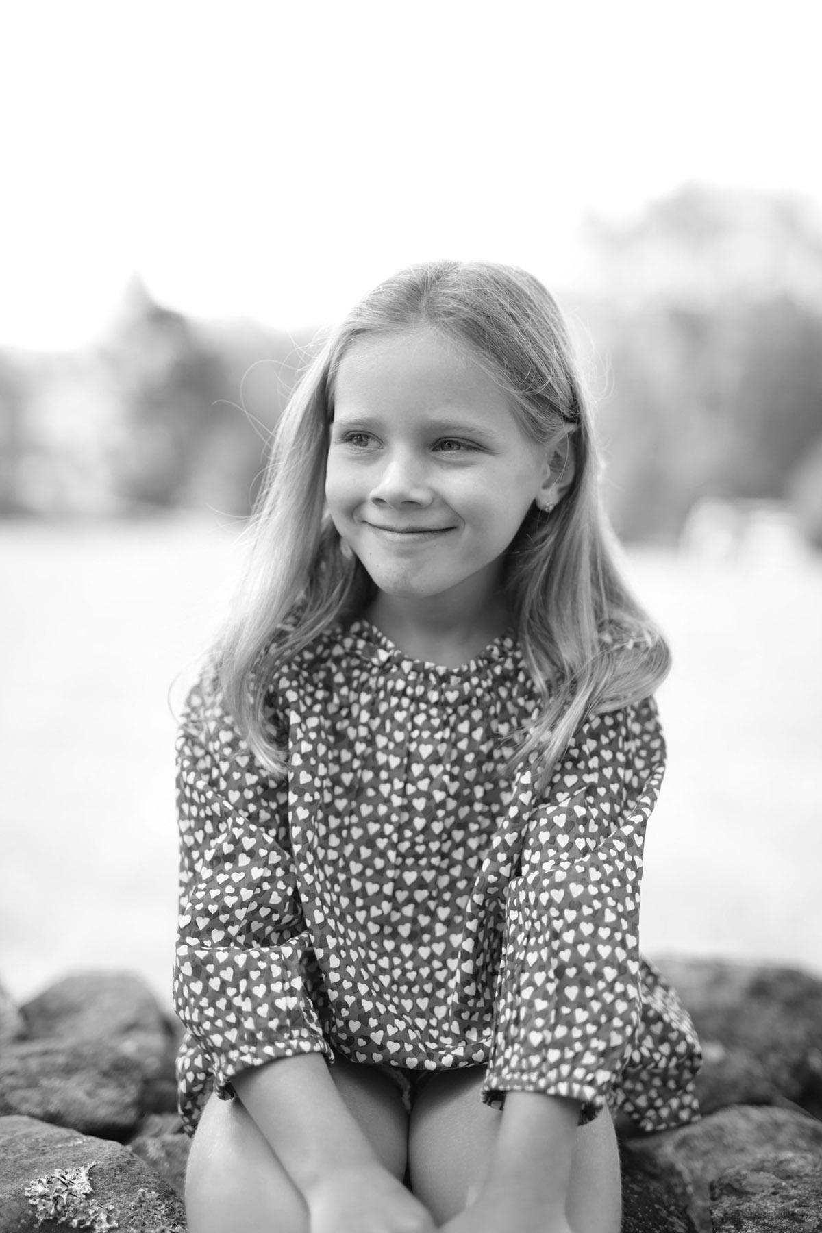 little girl on stone wall-KUP