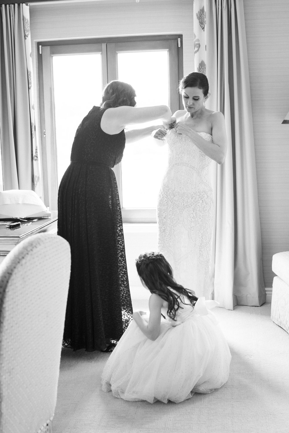 bride getting ready with bridesmaid and flower girl