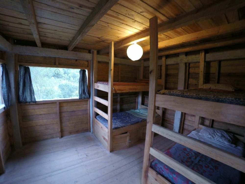 dorm rooms - Our mixed dorm rooms each include 2 bunk beds with comfortable single mattresses. Hate sleeping on the top bunk? So do we. That's why these beds were custom built by our local carpenter, and the beds have literally been nailed into the floor. No waking up in the middle of the night because the person below you is tossing and turning. You would swear you weren't in a bunk bed! Each bed includes a power outlet and personal light nearby, and a set of lockers underneath to store all of your valuables while you are out playing in the river.Q50 per person