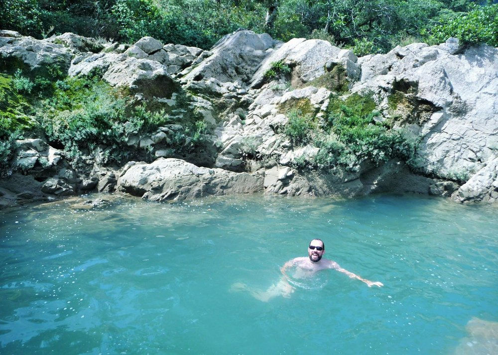 Mike swimming in the natural pool at Ch'i Bocól Community Hostel