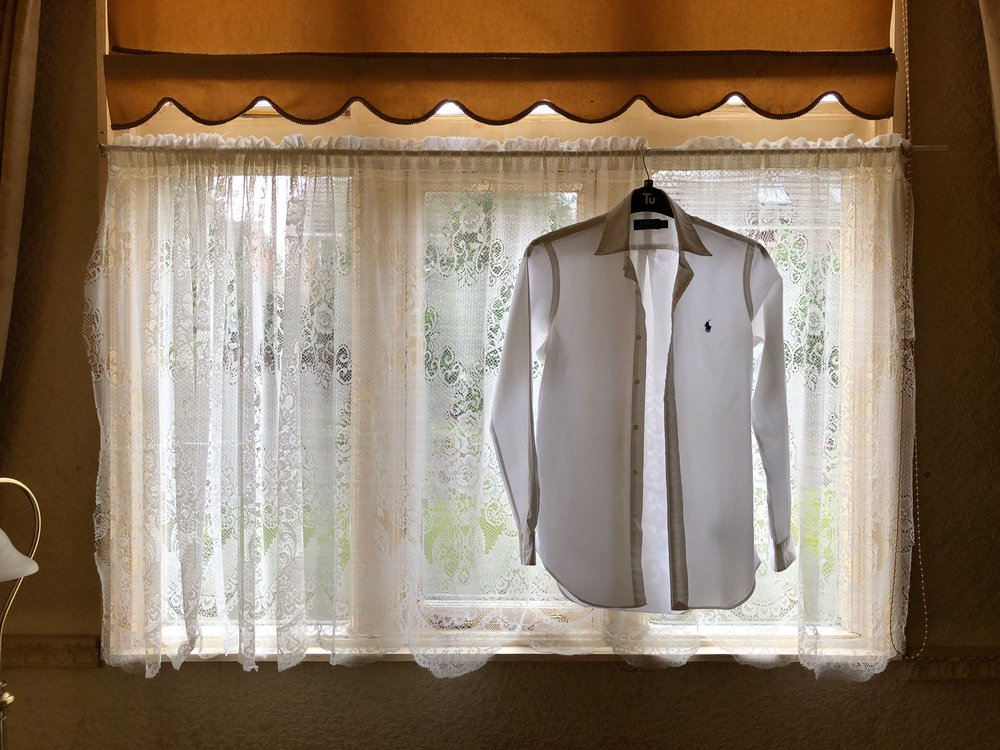 In this example, the shirt is the main element of the photo but the subject is the way the light shines through it and turns it into a kind of ghostly figure, floating in a dark room. The composition is simple. Aside from the shirt, it shows the source of light (the window) and enough of the wall to show that's hanging in a dimly-lit interior room. Nothing else is needed to make sense of the scene since there's no real story to tell. I just wanted to show how pretty it is that the shirt was illuminated like that. I wasn't too happy with the object creeping into the frame on the very left hand side as I think it's a little distracting in such a simple composition but to crop in any closer would mean losing too much of the wall and I felt that the wall was a part of the subject.