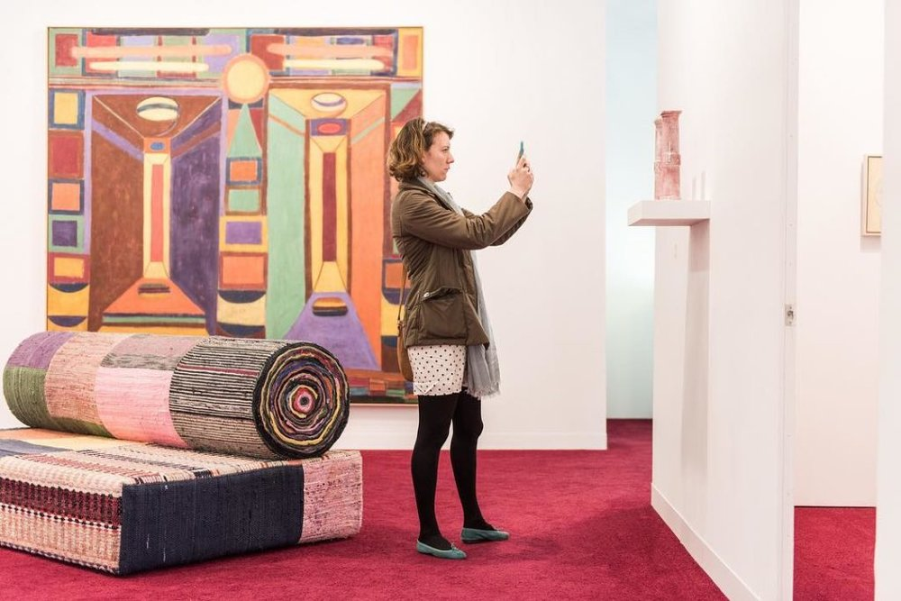 A visitor to the Armory Show 2018 at the booth of Victoria Miro Gallery. Photo: Facebook / Armory Show.  LINK TO ARTICLE HERE:   https://canadianart.ca/news/four-canadian-galleries-selected-for-nycs-armory-show/