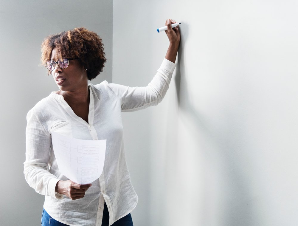 woman-at-whiteboard.jpg