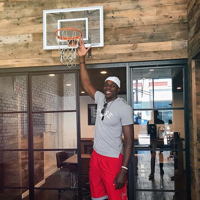 NBA veteran, Anthony Tolliver, stopped by to test out our basketball goal. Turns out it's not quite regulation size 🤷🏼‍♂️ #hookcreative #digitalagency #agencylife #downtownsgf  @atolliver44