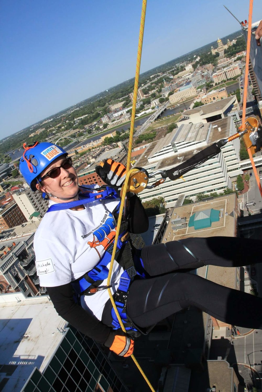 Michelle rappelling from a 27 story building in Des Moines, Iowa.