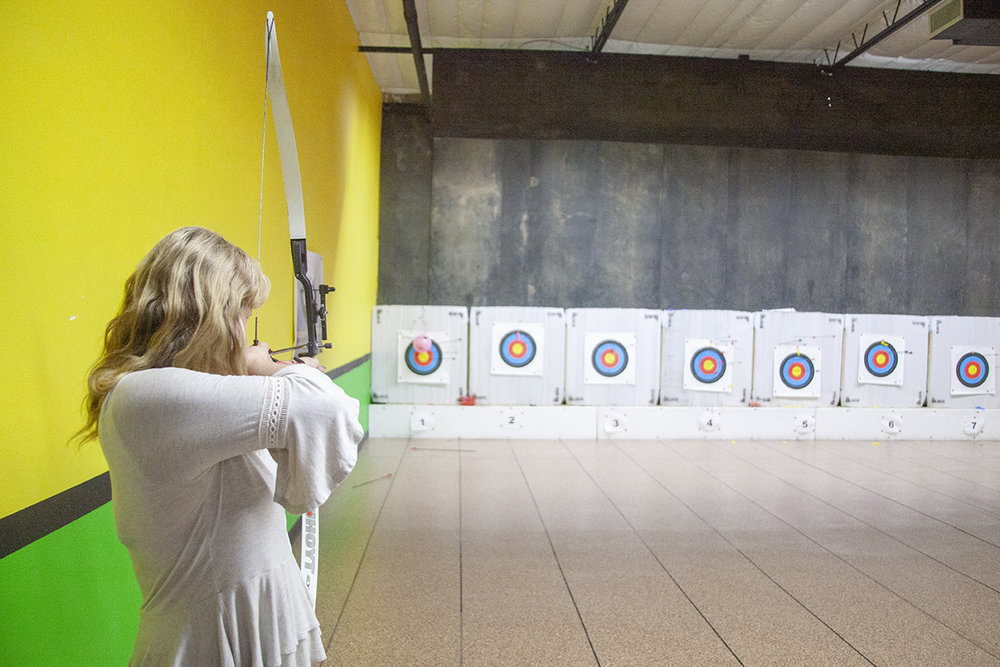 WoA member, Pam, aims true at Archery Headquarters.