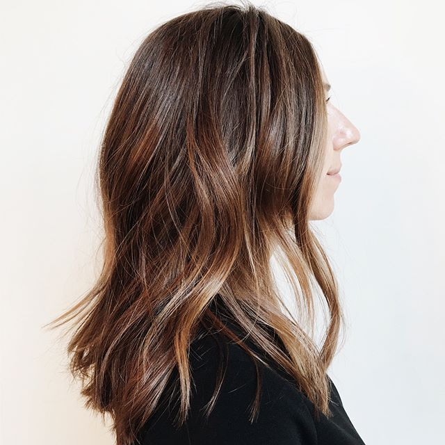 S W I P E  FOR  B E F O R E - From grown out balayage to sun kissed brunette. I like to call this the reverse balayage. I created a richer and warmer base color, melted it through some of the ends while reserving some dimension from the previous balayage and finished with an all over tone.