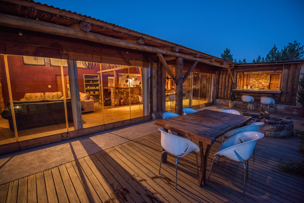 The deck and fire pit of King Cabin at the Kolkol Mountain Lodge.