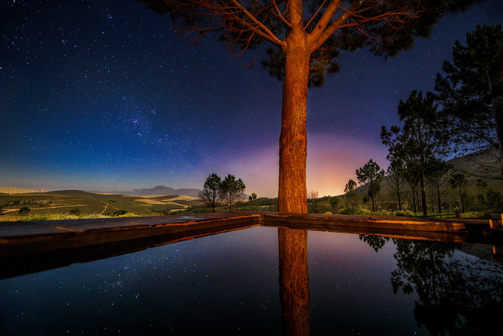 Midnight stars reflect in the wood-fired hot tub at Kolkol Mountain Lodge.