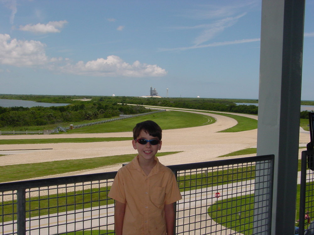 The author, 9 years old, visiting Kennedy Space Center. STS-114 (Discovery) sits on Pad 39-B in the background.