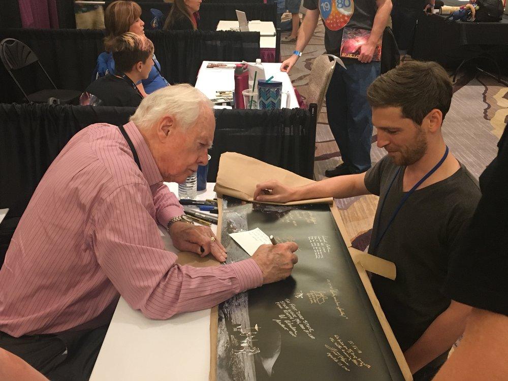 Dave Scott signs the panorama for Richard Garner.
