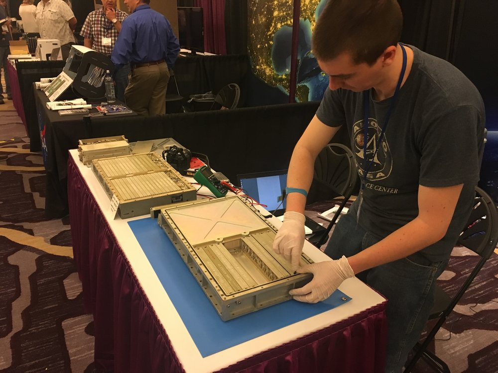 Mike Stewart removes a logic module from the AGC at Spacefest IX.