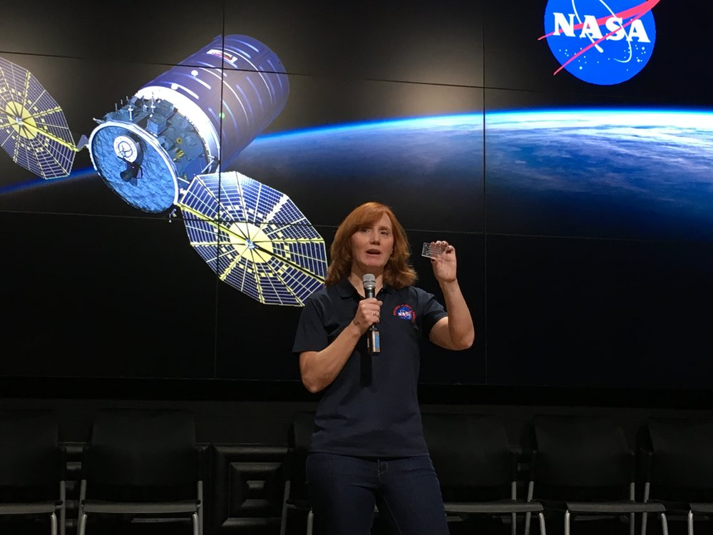 "Siobhan Malany holds a mockup of the ""lab-on-a-chip"" device carrying her research to the ISS."
