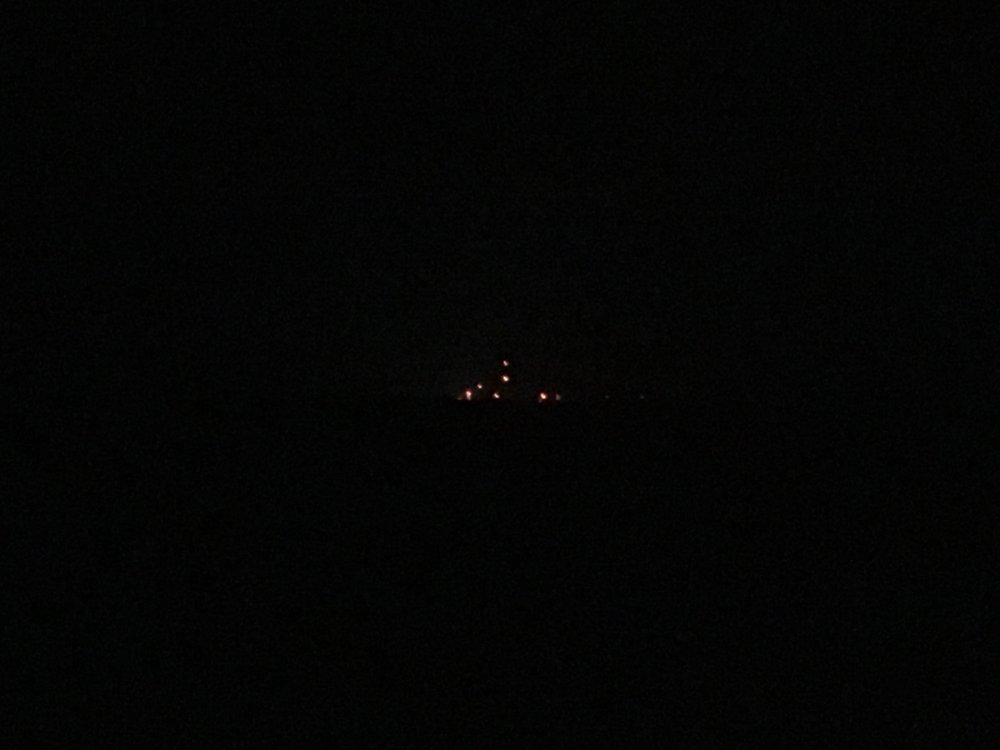 The lights of launchpad 0-A seen across the water from nearby Chincoteague Island.