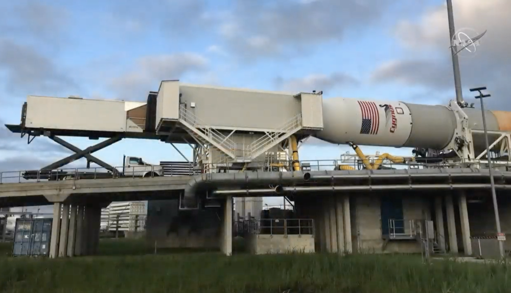 """The MPPF at Pad 0A. The facility allows access to the spacecraft via a """"pop top"""" in the nose cone of the rocket. (Image: NASA TV)"""