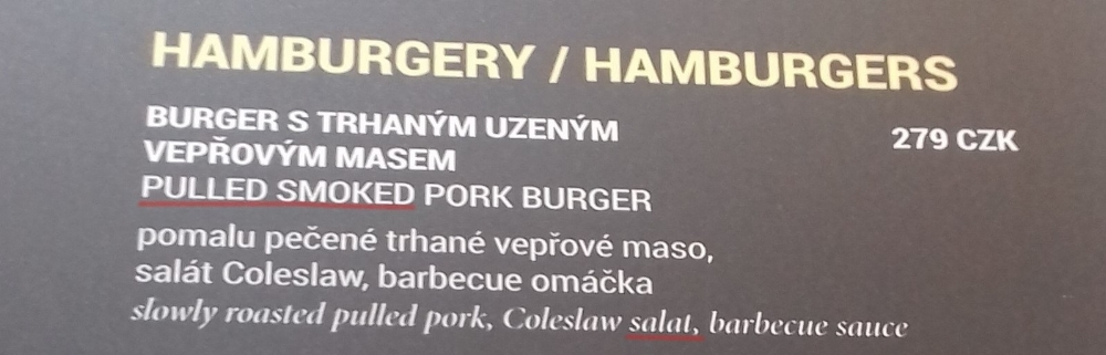My translation: SMOKEY PULLED PORK BURGER slow roasted pulled pork, coleslaw, barbecue sauce