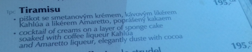 My translation: sponge biscuits, whipped cream, Kahlua and Amaretto liqueurs, dusting of cocoa powder