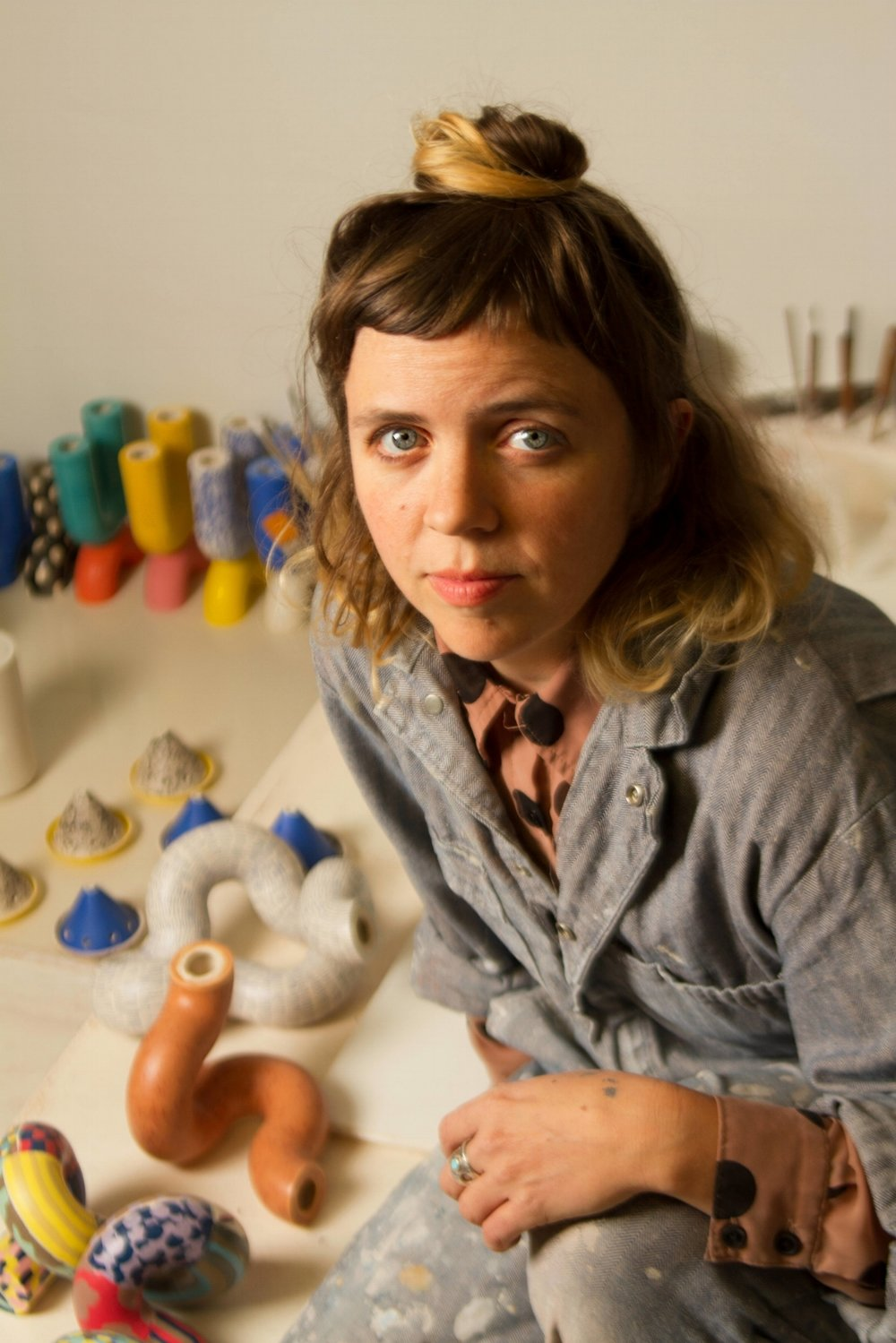 - Erin Smith works out of her windowless ceramics studio in South Minneapolis. She earned her BFA in Product Design from Parsons School of Design. All items are hand-made, no two are exactly alike.