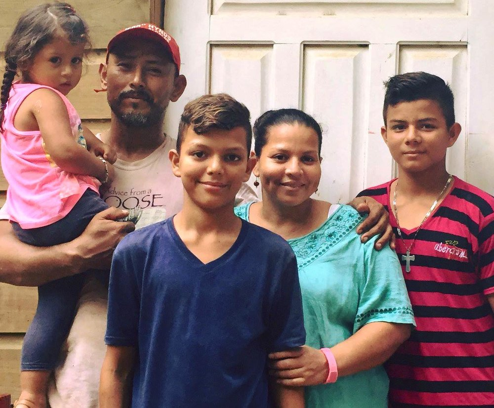 The Zelaya Family - Banesa and Darlin met each other 5 years ago. Banesa, (31) has 2 children that are from her first marriage. Jason is 16 years old and in 7th grade. William is 15 years old and in 5th grade. William spent 3 years in and out of school because Basena couldn't afford to pay it for it. Rebbeca is Banesa and Darlin's 3 year old daughter and they are expecting a new baby. Banesa is 7 months pregnant! Banesa is a kindergarten teacher and earns around $30 a month. She also does physical therapy and massages and makes about $17 per visit. Darlin, (37) never went to school. Darlin's parent couldn't afford to pay for his studies. His dad was as a watchman and his mom was a housekeeper. Jason and William's father does not help them economically. Even though Darlin is not Jason and William's biological dad, Darlin loves and supports them as if they were his own sons. Currently, Darlin works as a welder and he does a little bit of electrical work. He works welding and repairing AC of shipping boats. Daily, Banesa and Darlin work very hard to support each other.