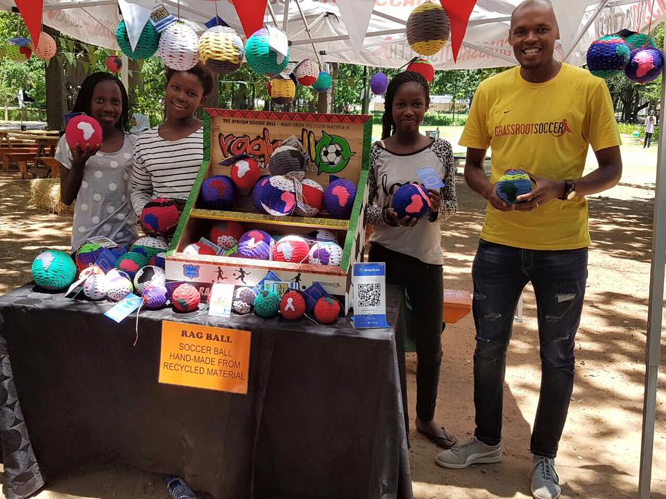 Coach Vuyo with RV Juniors at the Gardens Market in Cape Town