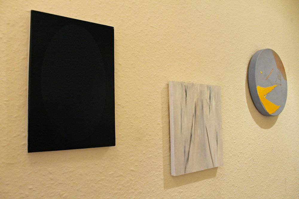 Installation view (Mirror by Molly Behagg, Rain on the road to Mbarara & Debris construction by Diana Palmer)