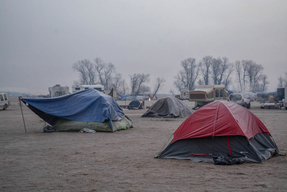 Water protectors camping out in the early morning frost.