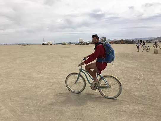 Your correspondent, trolling the playa. Photo credit: Matt Savoca