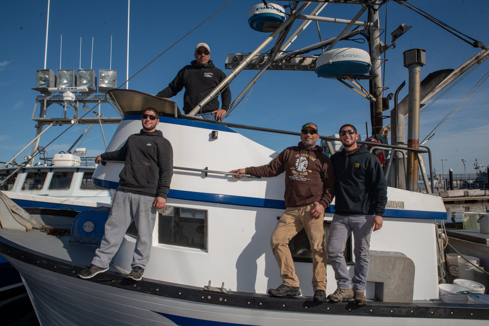 John Aliotti, top, on his boat, Defense, in Monterey Bay with his two sons, Joey (left) and Johnny (right), and crew member Billy Rose (center). Aliotti fishes for prawns in Monterey in the winter season.