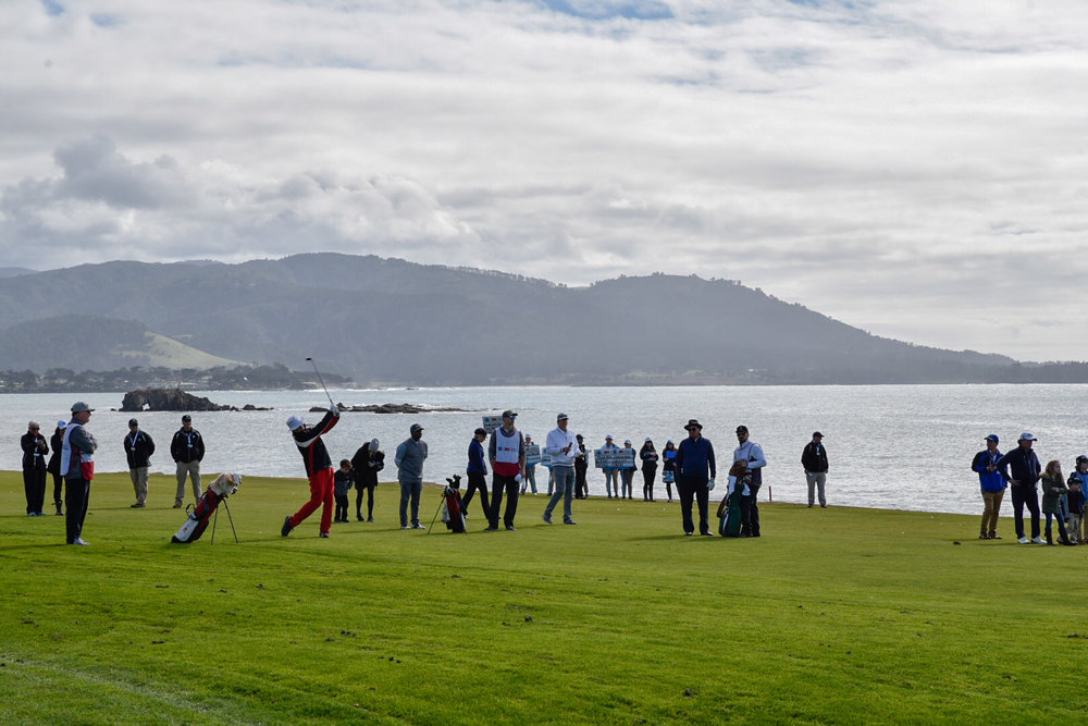 Bill Murray hits his approach shot on the 18th hole at Pebble Beach.