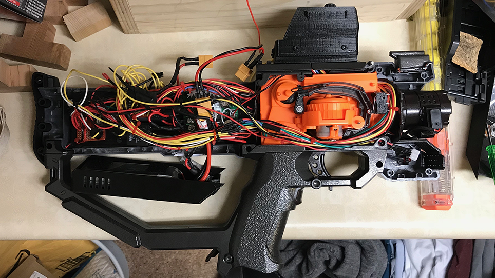 The mess of wires - In the future, I plan to purchase smaller gauge wire and rewire the entire blaster. Although it is doable, it is very hard cramming everything in to screw the shell on. I made the mistake of not accounting for the wire size in the initial design.