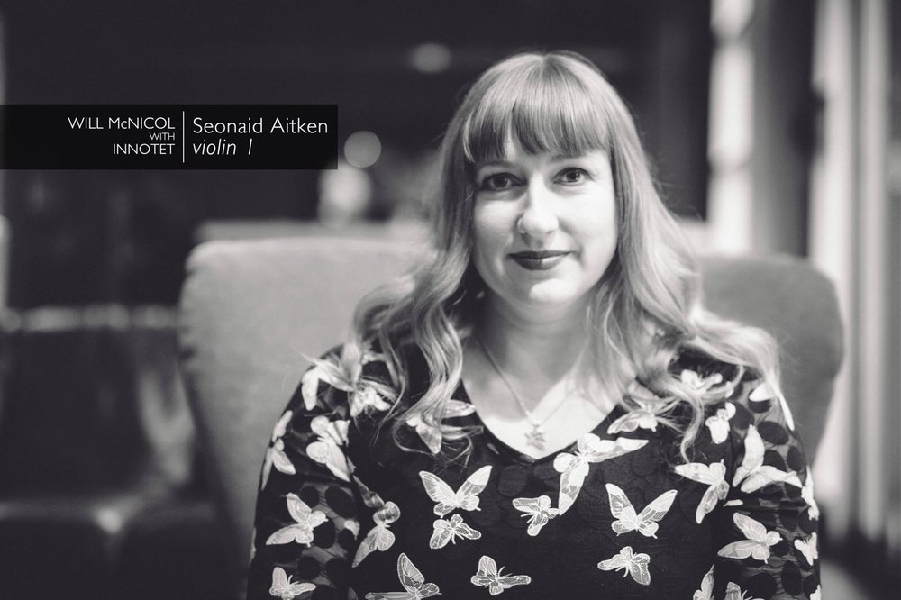 - Seonaid Aitken is a versatile, award-winning violinist, vocalist and composer/orchestrator from Fife, Scotland. Classically trained at the Guildhall School of Music and Drama (London), Seonaid has played regularly for 17 years with the Orchestra of Scottish Opera.She was awarded 'Best Vocalist' at the 2017 & 2018 Scottish Jazz Awards and, specialising in Gypsy Jazz, she performs extensively with her Scottish Jazz Award-winning 'Best Band' 2018 Rose Room, and as a guest with the Tim Kliphuis Sextet, Tokyo Django Collective, Swing 2018 and top jazz fingerstyle virtuoso, and former guitarist of Stephane Grappelli, Martin Taylor MBE.As an accomplished arranger and orchestrator, Seonaid's work is featured in the BBC/Richard Curtis film adaptation of Roald Dahl's 'Esio Trot' (starring Dustin Hoffman and Dame Judi Dench), the National Theatre of Scotland's production 'Dragon', and has been commissioned by the Royal Philharmonic Orchestra, Scottish Chamber Orchestra, Capella String Quartet, Scottish Session Orchestra, Blue Rose Code, John Goldie and the Red Hot Chilli Pipers.Learn more about Seonaid here.