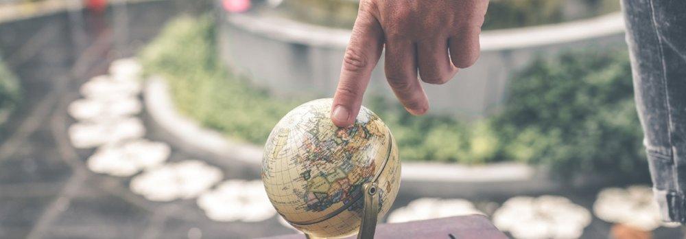 Person holding terrestrial globe  by Artem Bali  CC-0