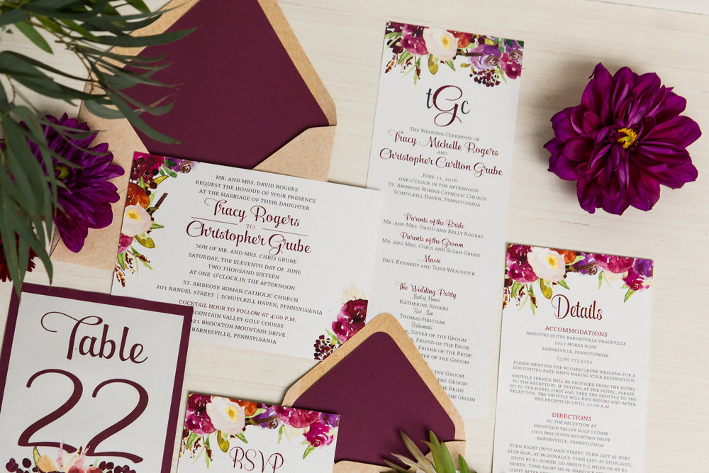 This wedding suite includes the invitation, programs, table numbers, placecards, envelope liners and more!