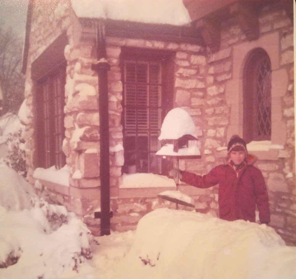My brother measuring the snow outside the front door of our home.