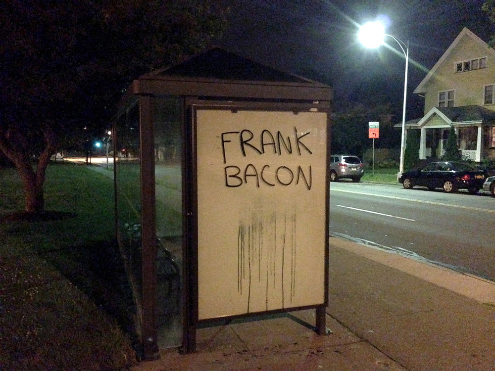 frank bacon on bus stop.jpg