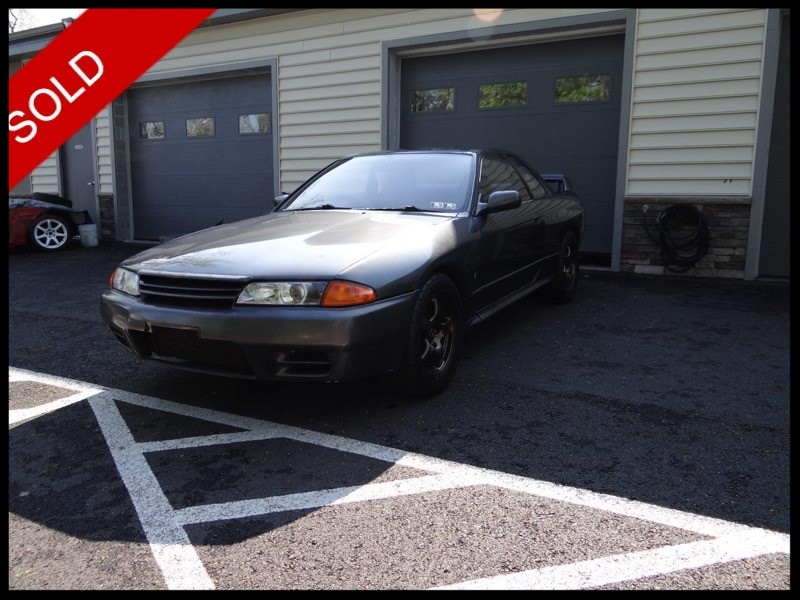 SOLD - 1991 Nissan Skyline GTRGunmetallic Grey on Blue/GreyVIN: BNR32212031