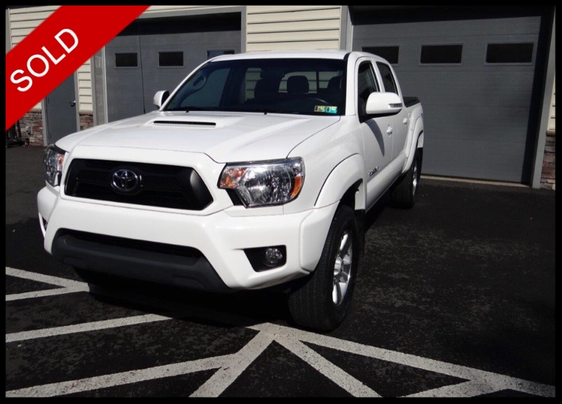 SOLD - 2015 Toyota Tacoma TRD Sport 4x4Super White on GraphiteVIN: 3TMLU4EN3FM186118