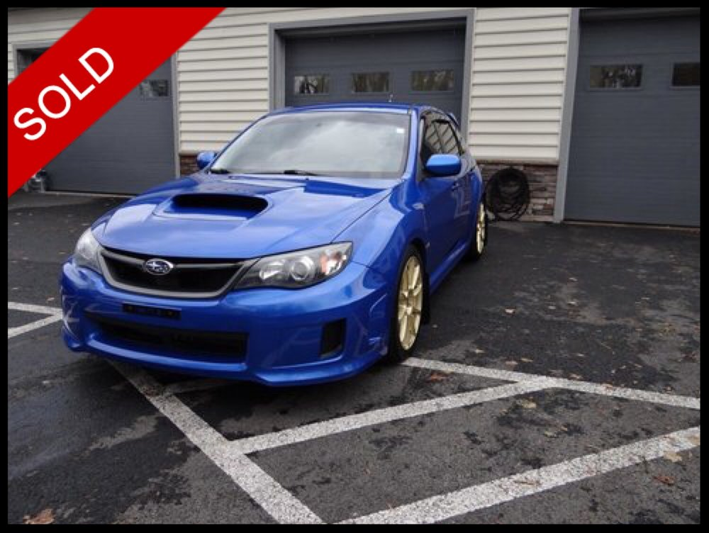 SOLD - Make: SubaruModel: Impreza WRX HatchbackMileage: 49,677 miExterior Color: WR Blue PearlInterior Color: BlackTransmission: 5-SpeedEngine: 2.5 LDrivetrain: AWDVIN: JF1GR7E69EG261626