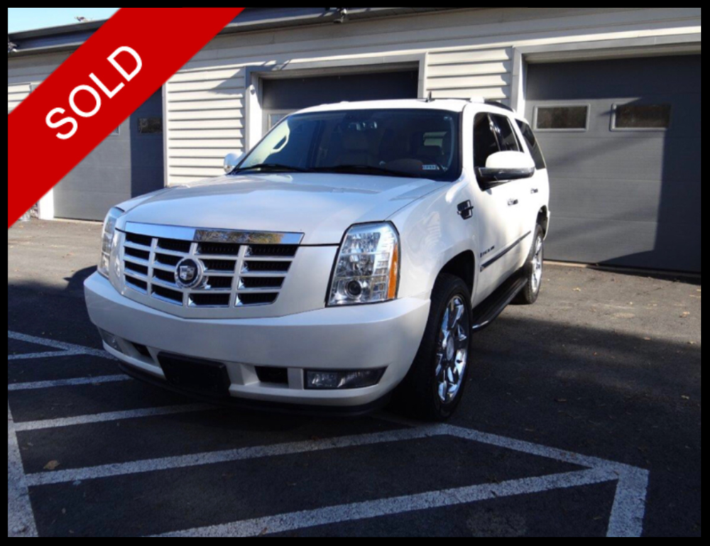 SOLD - Make: CadillacModel: EscaladeMileage: 119.033 miExterior Color: White DiamondInterior Color: TanTransmission: AutoEngine: 6.2 LDrivetrain: AWDVIN: 1GYFK638X7R203311