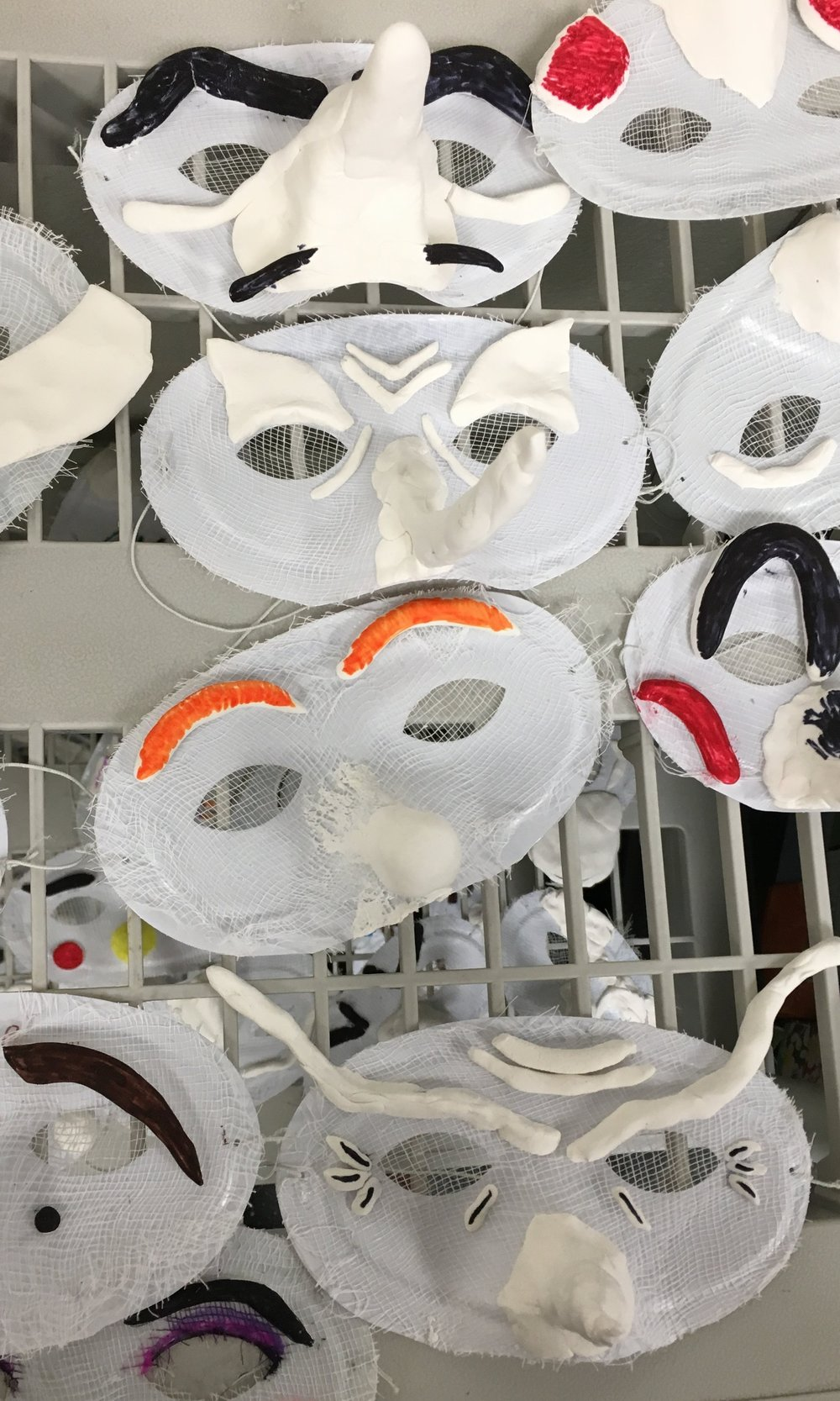Masks created by students at Daniel Wright Jr. High in a 10-week Commedia dell'Arte residency.