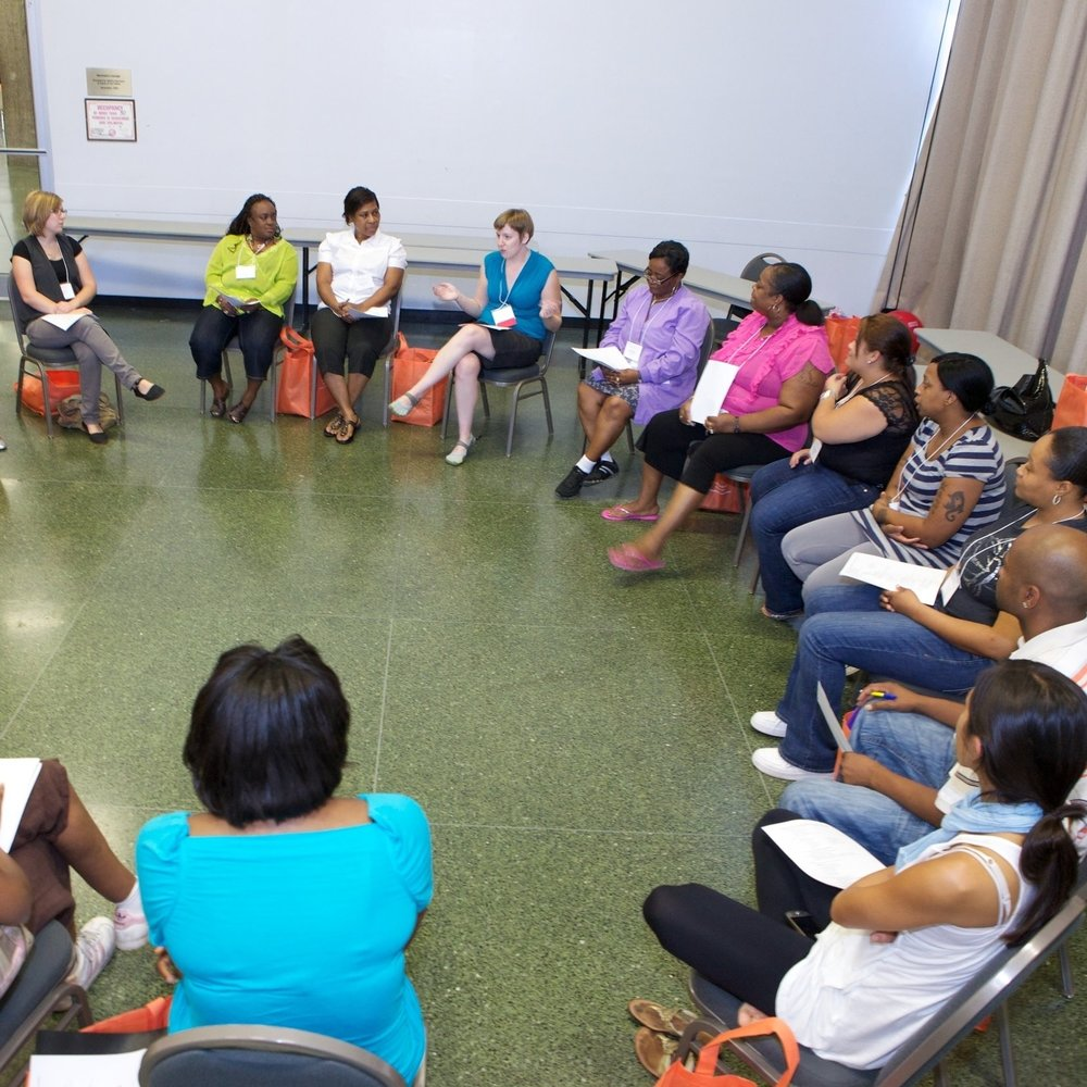 Educators at the Ounce of Prevention pre-service conference discuss the applications of the game they've just played.