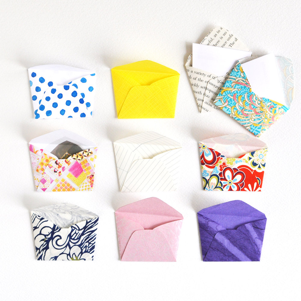 10 handmade, irregularly-shaped, mini envelopes in a variety of colours and patterns